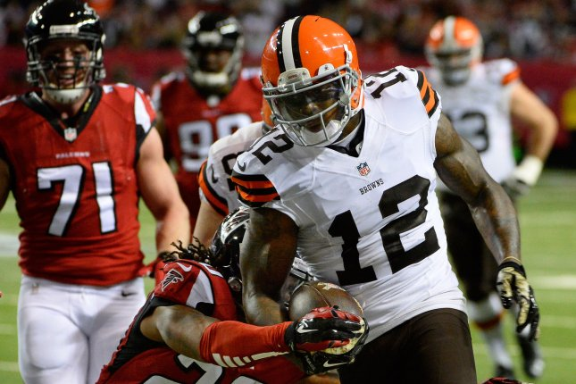 Cleveland Browns wide receiver Josh Gordon (12) drives for extra yardage against Atlanta Falcons safety Dwight Lowery (20) during the first half of their NFL game at the Georgia Dome in Atlanta on November 23, 2014. UPI/David Tulis