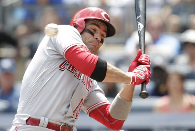 Joey Votto and the Cincinnati Reds sailed past the New York Mets on Thursday. Photo by John Angelillo/UPI