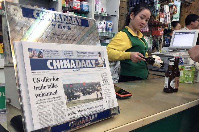 China's top foreign language newspaper featuring a front-page story on U.S.-China trade is sold in Beijing on September 16. File Photo by Stephen Shaver/UPI