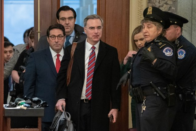 Members of President Donald Trump's defense team, Jay Sekulow and White House counsel, Pat Cipollone, enter the U.S Capitol on Saturday. Photo by Ken Cedeno/UPI