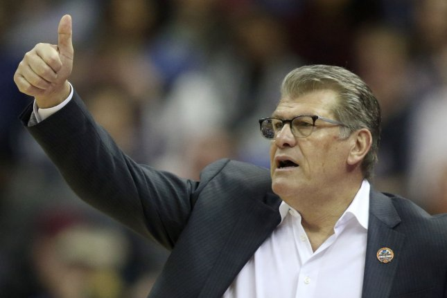 Head coach Geno Auriemma and the UConn Huskies women's basketball team will not play their first four planned games this season due to a positive COVID-19 test within the program. File Photo by Aaron Josefczyk/UPI