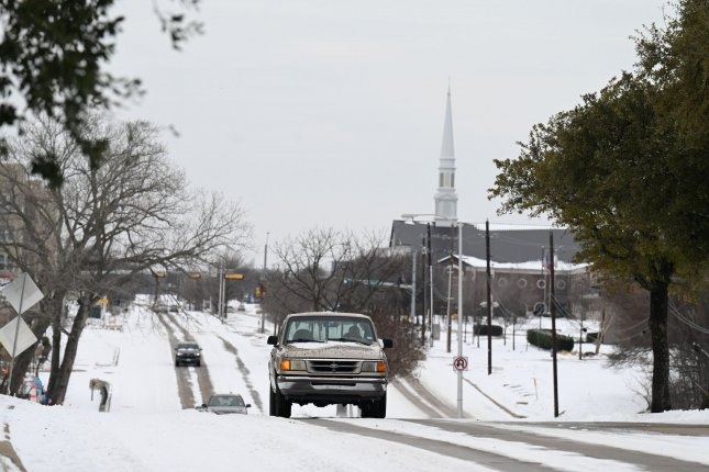 Rare snow is seen piled up on a road near Dallas on Tuesday. Record cold, snow and ice have blanketed the entire state and millions of customers in the state remained without power on Wednesday. Photo by Ian Halperin/UPI