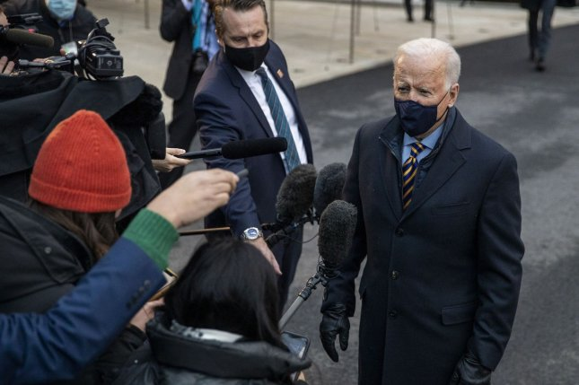 President Joe Biden speaks to reporters on Tuesday before he departs the White House for Wisconsin to participate in a town hall event. Photo by Shawn Thew/UPI