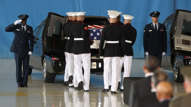 President Barack Obama watches while caskets are placed into vehicles during the Transfer of Remains Ceremony marking the return to the United States of the remains of the four Americans killed this week in Benghazi, Libya, at Joint Base Andrews near Washington, DC on September 14, 2012. UPI/Molly Riley/Pool
