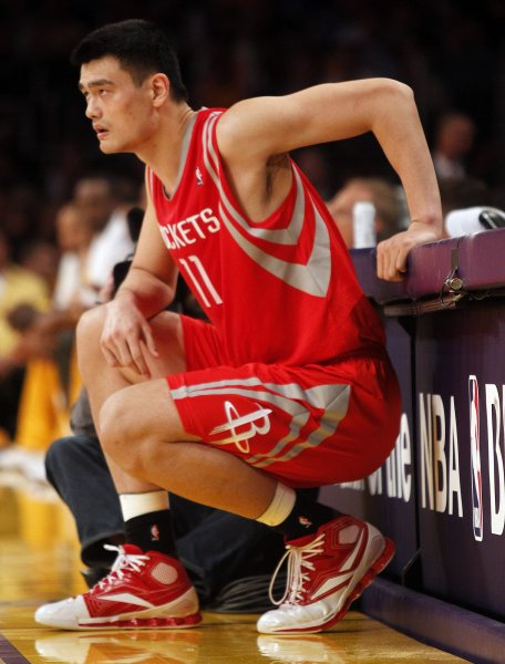 Houston Rockets center Yao Ming (11) waits to come in to the game against the Los Angeles Lakers in the second half of their NBA basketball game in Los Angeles on October 26, 2010. The Lakers won 112 to 110. UPI/Lori Shepler