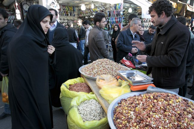 Iranian woman shops for nuts in Tehran market on March 19, 2012 as Iranians prepare to celebrate Nowruz, a festival that marks the start of the Iranian New Year. UPI/Maryam Rahmanian