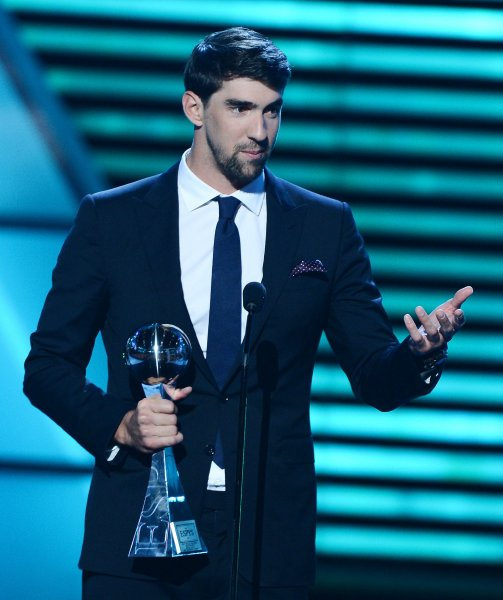 Michael Phelps, shown here at the 2013 ESPY Awards, was chosen the U.S. Olympic Team's ceremonial flag bearer, and will lead the team into Rio de Janeiro's Marancana Stadium on Friday. File Photo by Jim Ruymen/UPI