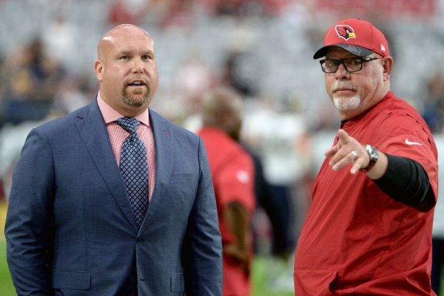 Arizona Cardinals general manager Steve Keim (L) and former Cardinals head coach Bruce Arians talk before the Cardinals-Los Angeles Rams game on October 2, 2016 at University of Phoenix Stadium in Glendale, Arizona. File photo by Art Foxall/UPI