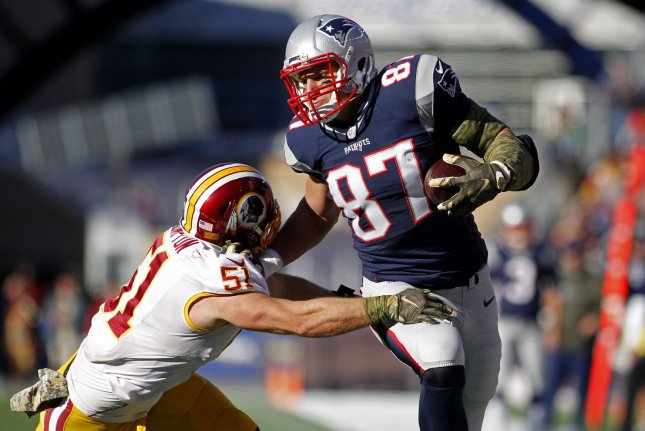 New England Patriots tight end Rob Gronkowski (87) tries to dodge a tackle from Washington Redskins linebacker Will Compton on a 15-yard reception in the second quarter on November 8, 2015 at Gillette Stadium in Foxborough, Massachusetts. File photo by Matthew Healey/UPI