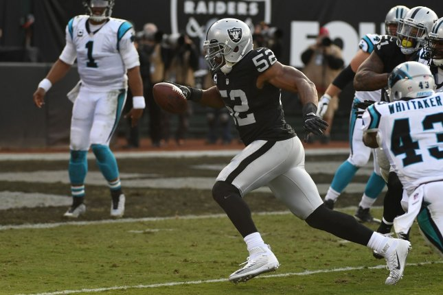 Carolina Panthers quarterback Cam Newton (1) watches as former Oakland Raiders defensive end Khalil Mack (52) runs an interception in for a touchdown in the second quarter on November 27, 2016 at the Oakland Alameda County Coliseum in Oakland, California. File photo by Terry Schmitt/UPI