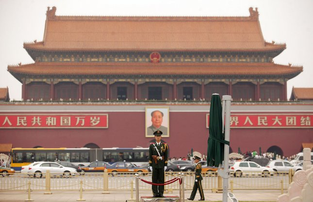 Chinese soldiers patrol next to Tiananmen Square the site of a massacre by Chinese military forces against civilians 30 years ago. File Photo by Stephen Shaver/UPI