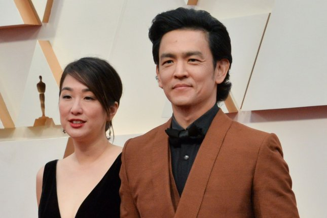John Cho (right) and his wife Kerri Higuchi arrive for the 92nd annual Academy Awards on February 9. Cho has released an essay about the discrimination Asian Americans are facing. File Photo by Jim Ruymen/UPI