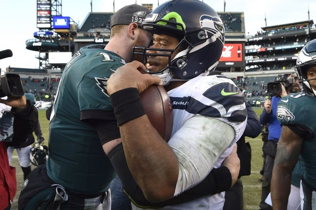 NFL players like Seattle Seahawks quarterback Russell Wilson (R) and Philadelphia Eagles quarterback Carson Wentz (L) must remain six feet apart and will not be allowed to trade jerseys after games during the 2020 season. File Photo by Derik Hamilton/UPI