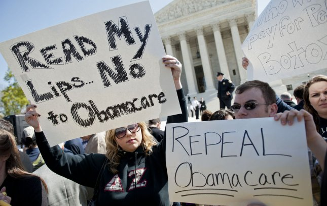 Anti-health care reform supporters protest in front of the U.S. Supreme Court as the court begins hearing arguments on the constitutionality of President Obama's health care bill in Washington, D.C. on March 26, 2012. UPI/Kevin Dietsch