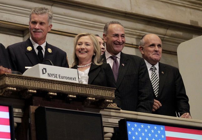 Secretary of State Hillary Rodham Clinton, U.S. Senator Charles E. Schumer and Former New York City Mayor Rudolph Giuliani wait for a moment of silence before the opening bell at the New York Stock Exchange 2 days before the 10th Anniversary of the terrorist attacks on 9/11on Wall Street In New York City on September 9, 2011. UPI/John Angelillo