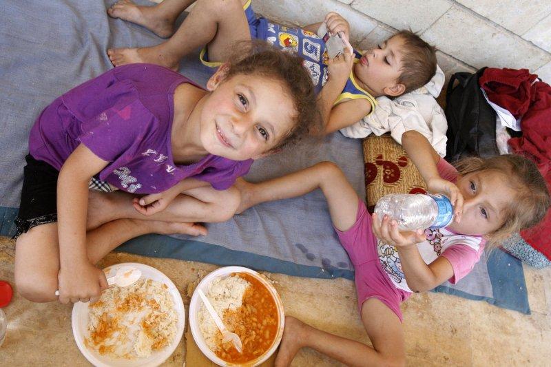 U.S. airdrops water, food to Yazidis in Iraq
