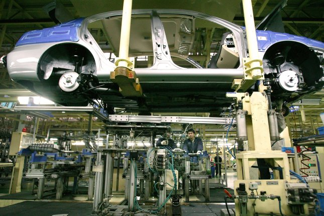 Workers assemble vehicles at Hyundai's automobile production plant in Beijing, China. Four Hyundai plants in China resumed production after a supplier restarted deliveries over delayed payments. File Photo by Stephen Shaver/UPI