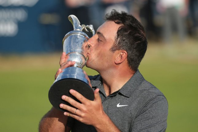 Italy's Francesco Molinari kisses the Claret Jug after victory in the 2018 Open Golf championships on Sunday in Carnoustie, Scotland. Photo by Hugo Philpott/UPI