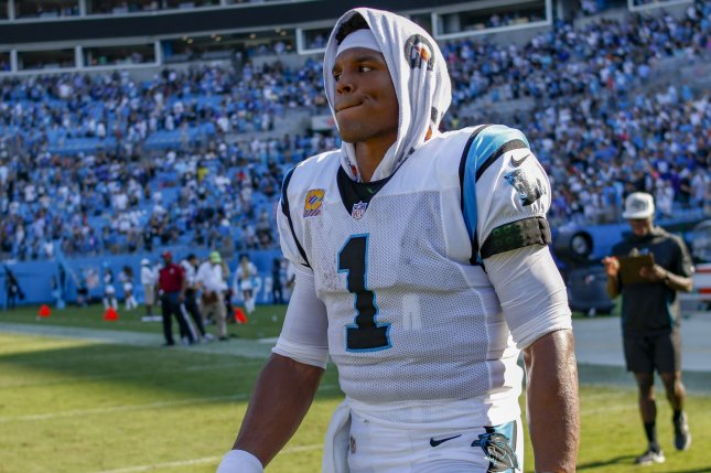 Carolina Panthers quarterback Cam Newton walks off the field after the Panthers defeated the New York Giants 33-31 in an NFL football game on October 7 in Charlotte, N.C. Photo by Nell Redmond/UPI