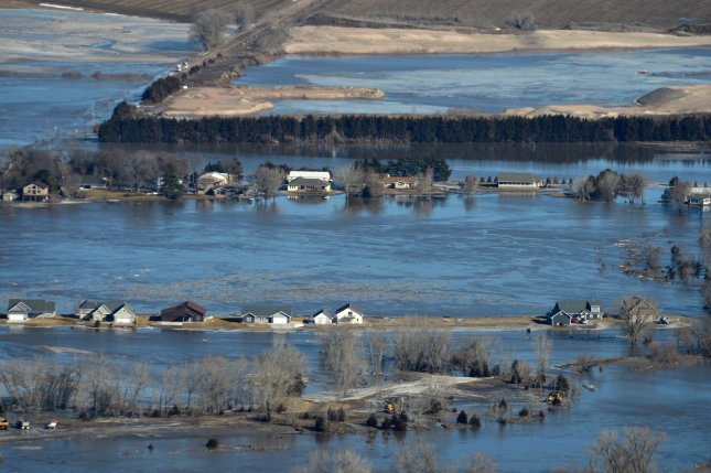 Historic flooding conditions in a portion of northeast Nebraska are show in this aerial view from mid-March. Photo by Senior Airman Jamie Titus/Nebraska National Guard