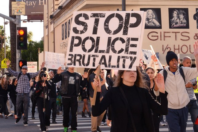 Hundreds march in the Hollywood section of Los Angeles on December 13, 2014, after a series of police officer-involved deaths. The rally occurred five months after the choking death of Eric Garner in New York City. File Photo by Jim Ruymen/UPI