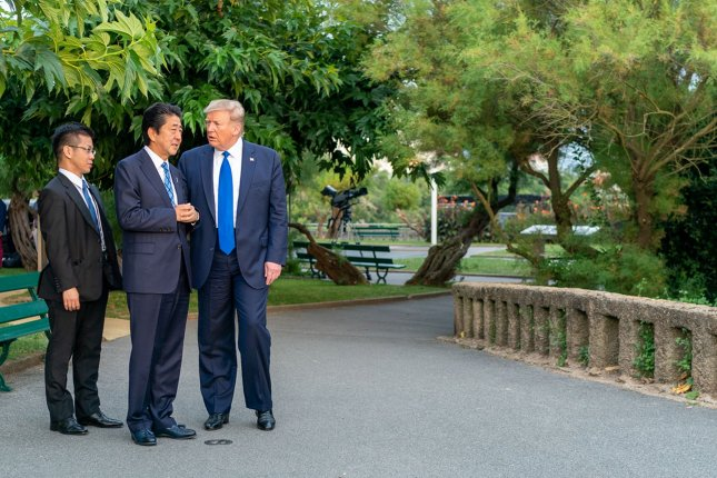 President Donald Trump speaks with Japanese Prime Minister Shinzo Abe on the sidelines at the G7 summit in Biarritz, France, on August 24. The 2020 summit will be held at Camp David in Maryland. File Photo by Shealah Craighead/White House/UPI