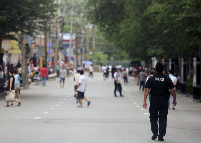 Han Chinese police patrol the streets during Ramadan in what many consider the Muslim capital of China, Urumqi, the capital of China's predominantly Muslim and restive Xinjiang Province, on June 29, 2015. Photo by Stephen Shaver/UPI