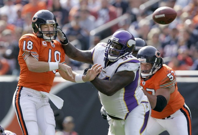 Minnesota Vikings defensive lineman Pat Williams (94) pressures Chicago Bears quarterback Kyle Orton (18) during the second quarter at Soldier Field on Oct. 19, 2008, in Chicago. Williams was one of six players suspended Tuesday by the NFL. (UPI Photo/Brian Kersey)