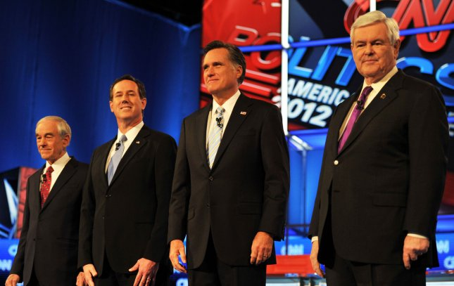 Ron Paul, Rick Santorum, Mitt Romney, and Newt Gingrich (L-R) stand on stage before the start of the Republican Presidential Debate at the Mesa Arts Center in Mesa, Arizona, February 22, 2012. UPI /Art Foxall