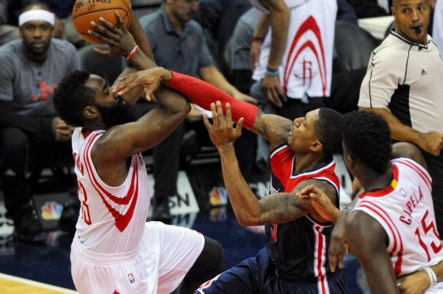 Houston Rockets guard James Harden (13) is fouled by Washington Wizards guard Bradley Beal (3) in the first half at the Verizon Center in Washington, D.C. on November 7, 2016. Photo by Mark Goldman/UPI