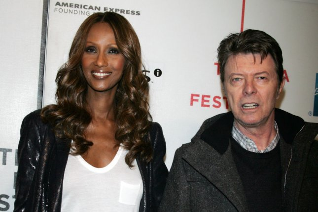 Iman (L) and David Bowie at the Tribeca Film Festival premiere of Moon on April 30, 2009. The singer died at age 69 in January 2016. File Photo by Laura Cavanaugh/UPI