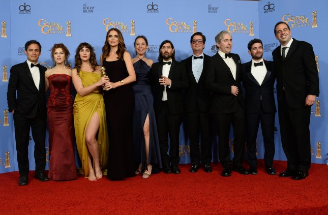 From left, actors Gael Garcia Bernal, Bernadette Peters, Lola Kirke, Saffron Burrows, Jason Schwartzman, and the team from Mozart in the Jungle, winners of the award for Best Television Series -- Musical or Comedy, appear backstage during the 73rd annual Golden Globe Awards in Beverly Hills on January 10, 2016. The show has been renewed for a fourth season. Photo by Jim Ruymen/UPI