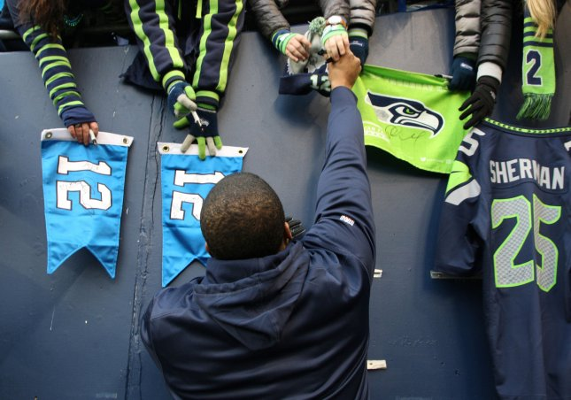 Seattle Seahawks middle linebacker Bobby Wagner (54) autograph fans flags and jerseys before their NFL playoff Wild Card game against the Detroit Lions at CenturyLink Field in Seattle, Washington on January 7, 2017. Photo by Jim Bryant/UPI