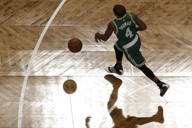 Boston Celtics' Isaiah Thomas extended his club record by making a 3-pointer in his 44th straight game as the Celtics handled the Wolves 117-104, their 11th consecutive home victory over Minnesota. File Photo by John Angelillo/UPI
