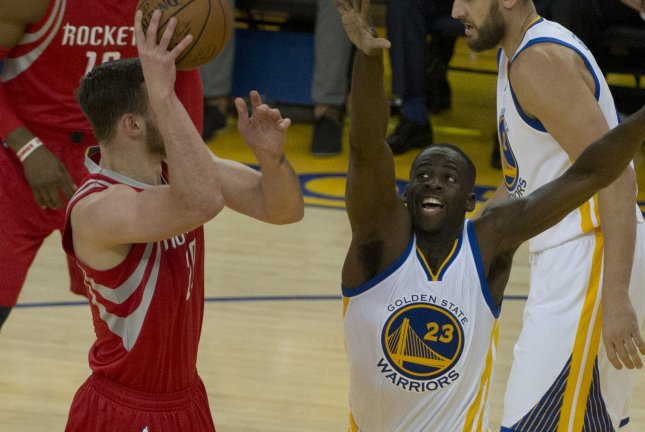 b7bd8e8423de Houston Rockets Donatas Motiejunas (L) shoots over Golden State Warriors  Draymond Green (23) in 2016. The 7-foot center is set to return to the NBA  after ...
