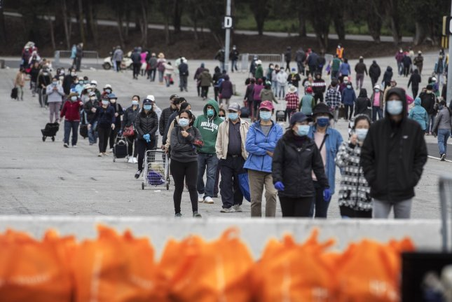 New research suggests roughly 30,000 people have died because of unemployment during the coronavirus pandemic, which also has increased the number of people lining up at food banks across the country. File Photo by Terry Schmitt/UPI