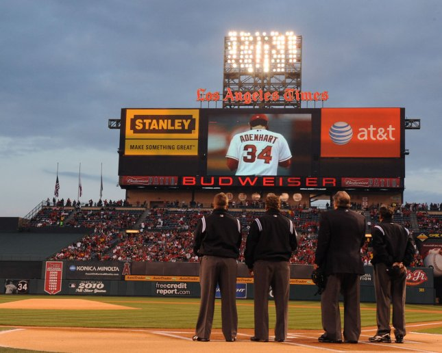 A video tribute to pitcher Nick Adenhart is played at Angels Stadium in Anaheim, Calif, April 10, 2009. Adenhart was killed in a car crash the previous day. (UPI Photo/Jim Ruymen)