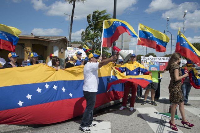 The political crisis in Venezuela has created demonstrations worldwide. About 3,000 protesters took to the streets of Caracas, demanding for the release of political prisoners. File Photo by Gary I Rothstein/UPI