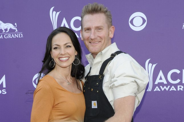 Joey (L) and Rory Feek arrive at the 48th annual Academy of Country Music Awards on April 7, 2013. The married couple recently shared their first video of daughter Indiana speaking. File Photo by David Becker/UPI