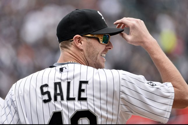 Former Chicago White Sox starting pitcher Chris Sale stands on the field as he is introduced before the White Sox's home opener against the Minnesota Twins at U.S. Cellular Field in Chicago on April 10, 2015. Photo by Brian Kersey/UPI