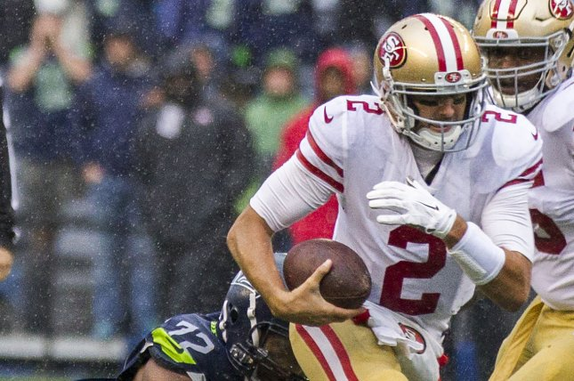 Seattle Seahawks defensive end Michael Bennett (72) tackles San Francisco 49ers quarterback Brian Hoyer (2) for a 2-yard loss at CenturyLink Field in Seattle, Washington on September 17, 2017. File photo by Jim Bryant/UPI
