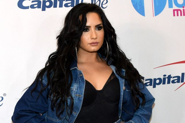 Demi Lovato will host group therapy-like sessions prior to concerts on her Tell Me You Love Me tour. File Photo by Gary I. Rothstein/UPI