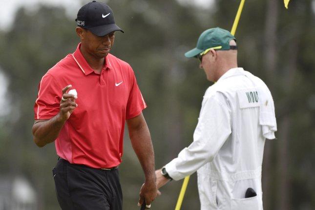Tiger Woods reacts after making a putt for par on the first hole in the final round of the 2015 Masters Tournament at Augusta National Golf Club in Augusta, Ga. File photo by Kevin Dietsch/UPI
