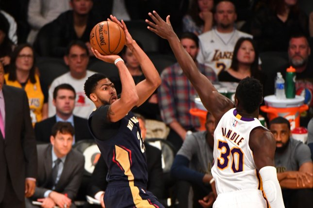 c45d47a81 New Orleans Pelicans forward Anthony Davis shoots over Los Angeles Lakers  forward Julius Randle on March 5