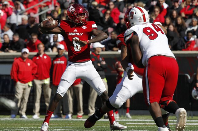 Louisville Cardinals quarterback Lamar Jackson (8) throws under pressure from NC State's defense during the first half of play on October 22, 2016 at Papa John's Cardinal Stadium in Louisville, Kentucky. File photo by John Sommers II/UPI