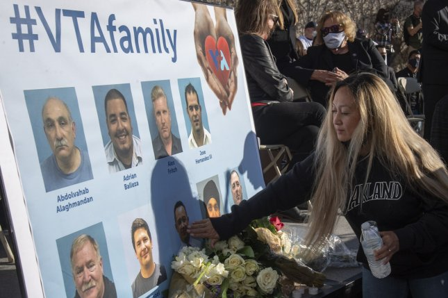 Mourners attend a memorial vigil last Thursday for nine slain transit workers who were killed in a shooting attack at a transit yard in San Jose, Calif. Photo by Terry Schmitt/UPI