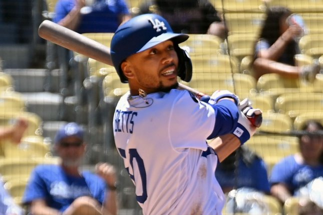Los Angeles Dodgers outfielder Mookie Betts hits a solo home run in the third inning off Texas Rangers starting pitcher Dane Dunning on Sunday at Dodger Stadium in Los Angeles. Photo by Jim Ruymen/UPI