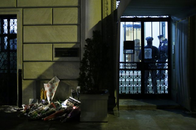 Two NYPD Police Officers stand inside the French Consulate building in New York City on January 9 after gunmen opened fire at the offices of the French satirical publication Charlie Hebdo and a kosher market. The New York Police Department issued a warning to its officers to be on heightened alert following a renewed terrorist threat. Photo by John Angelillo/UPI