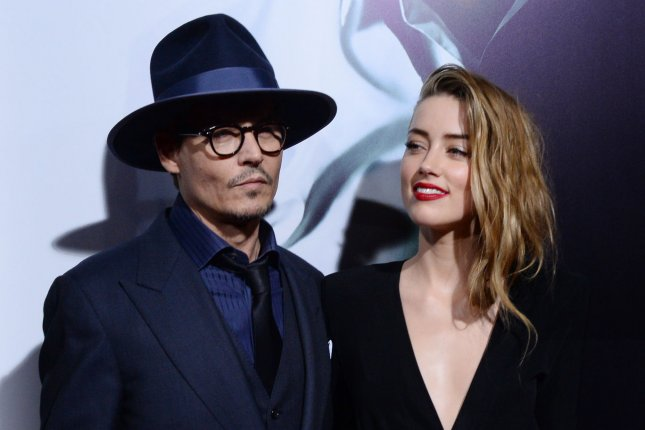 Amber Heard and Johnny Depp pictured on February 12, 2014. File photo by Jim Ruymen/UPI