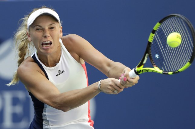 Caroline Wozniacki of Denmark hits a backhand to Madison Keys of the United States in her straight sets victory in the 4th round in Arthur Ashe Stadium at the 2016 US Open Tennis Championships at the USTA Billie Jean King National Tennis Center in New York City on September 4, 2016. Photo by John Angelillo/UPI